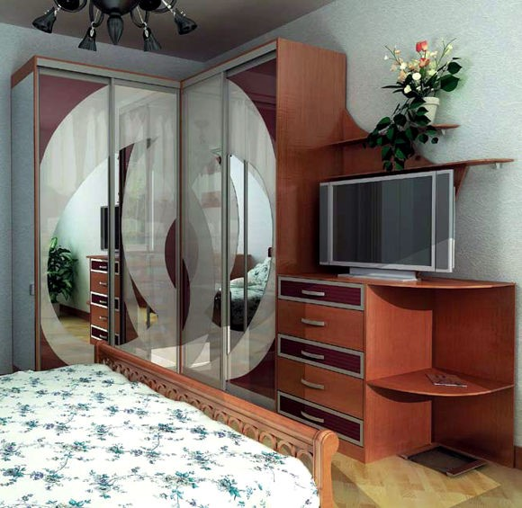 Угловой шкаф-купе в маленькой спальне